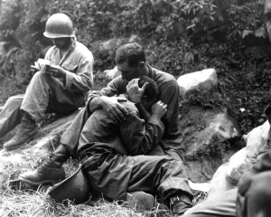Grief stricken american soldier; Haktong-ni area of Korea, 28 August 1950